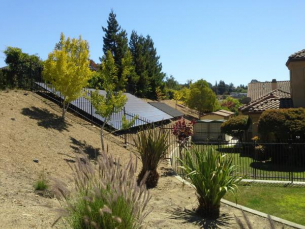 Solar Power Panels In The Backyard Of A Single Family Residential Property.