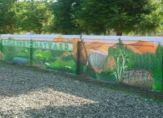 Examples of murals painted on sound walls.