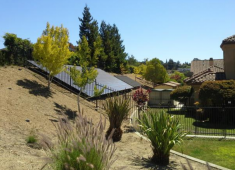 Solar power panels in the backyard of a single-family residential property.