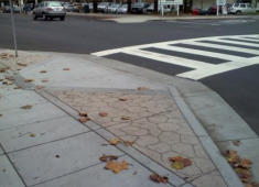 Example of neighborhood traffic calming measure: bulb-out at pedestrian crossing.
