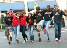 College students celebrating at a Downtown Street Party.  Courtesy of Cathy Breslow.